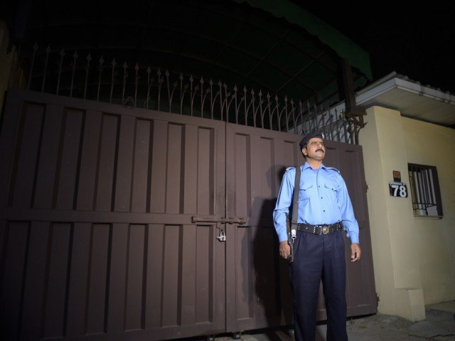 news cameramen take footage of the office of the international charity 039 save the children 039 sealed by order of authorities in islamabad on june 11 2015 as a policeman stands guard outside the building photo afp