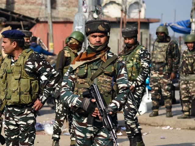 indian forces patrol the site of grenade blast in srinagar photo getty