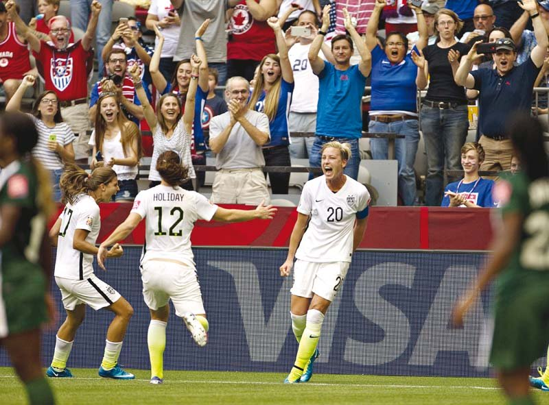 usa captain abby wambach who scored her 183rd international just before half time has 14 world cup goals and is just one shy of brazil star marta s record 15 photo afp
