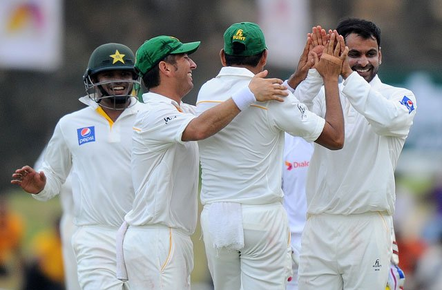 pakistan cricketer mohammad hafeez r and teammates celebrate after the dismissal of unseen sri lankan cricketer lahiru thirimanne during the second day of the opening test cricket match between sri lanka and pakistan at the galle international cricket stadium in galle on june 18 2015 photo afp