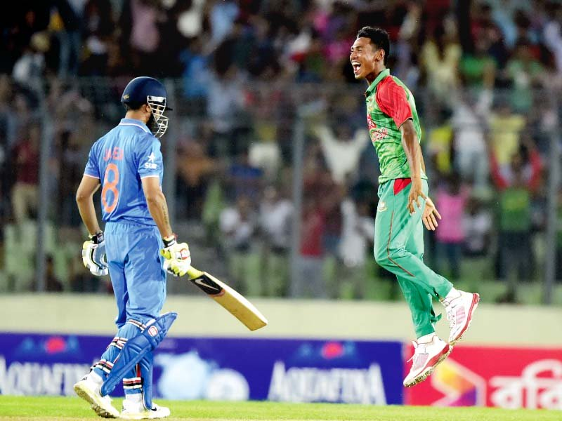 mustafizur jumps in the air after dismissing ravindra jadeja on his way to a six wicket haul photo afp