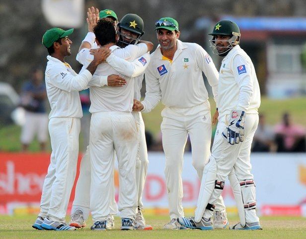 pakistan cricket team captain misbah ul haq 2r and teammates celebrate the dismissal of sri lankan cricketer kumar sangakkara during the fourth day of the opening test match between sri lanka and pakistan at the galle international cricket stadium in galle on june 20 2015 photo afp