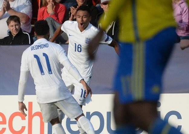 jesse lingard of england c celebrates with his teammate nathan redmond after scoring against sweden during the uefa under 21 european championship photo afp