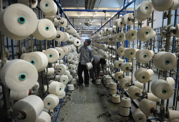 textile exports in the first 11 months of fiscal year 2015 stood at 12 25 billion down 1 7 compared to the previous year photo afp