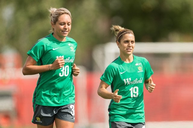 australia 039 s kyah simon l and katrina gorry jog during the team 039 s practice session in edmonton canada on june 23 2015 the australians await the result of tonight 039 s match between japan and the netherlands to learn their opponent in the quarterfinals at the fifa women 039 s world cup photo afp