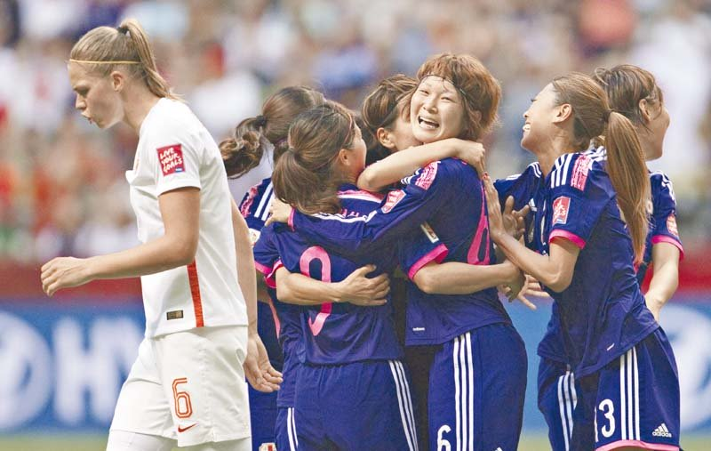 japan s saori ariyoshi and mizuho sakaguchi scored in either half for the defending champions who are the only team left in canada to have won all their matches photo afp