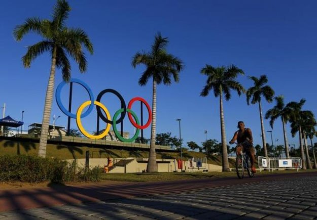 a man exercises next to the olympic rings placed at the madureira park ahead the rio 2016 olympic games in rio de janeiro photo reuters