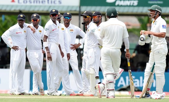 sri lankan cricketers wait for a third umpire decision against pakistan cricketer younis khan r during the opening day of the second test match between sri lanka and pakistan at the p sara oval cricket stadium in colombo on june 25 2015 pakistan captain misbah ul haq won the toss and elected to bat in the second test against sri lanka at the p sara oval in colombo photo afp
