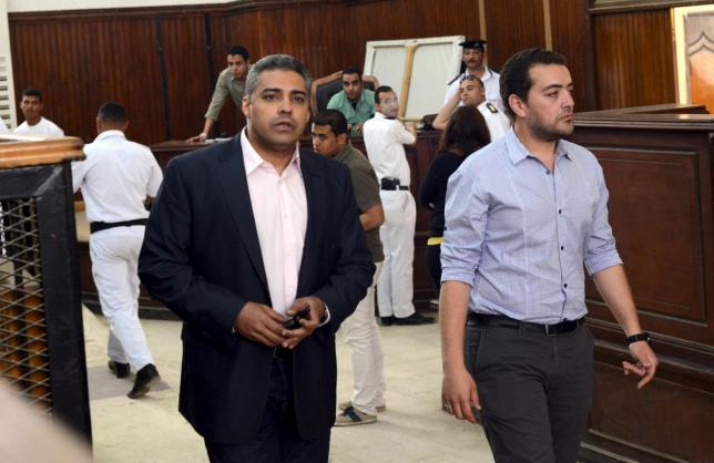 al jazeera television journalists mohamed fahmy l and baher mohamed are seen at a court in cairo after their retrial april 22 2015 photo reuters