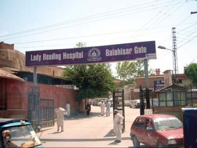 lady reading hospital photo express