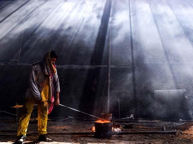 a pakistani labourer working at an iron factory photo afp
