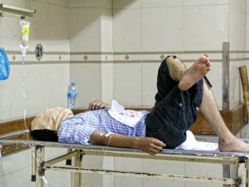 a patient lies on an examination table after being administered a drip abbasi shaheed hospital is running out of space to facilitate the number of patients that are coming in with heat related illnesses photo aysha saleem express