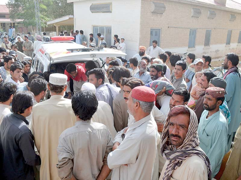 relatives gather as rescue workers shift mastung accident victims photo express