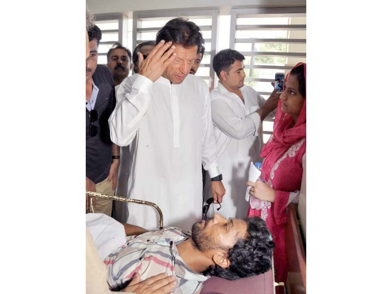 pti chief imran khan inquires about the well being of a heatstroke patient in jinnah hospital photo mohamad azeem express