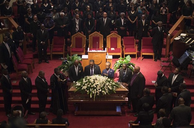 reverends al shapton 2nd r and jesse jackson c stand behind the casket holding emanuel ame church shooting victim ethel lance during her funeral at the royal missionary baptist church in north charleston south carolina june 25 2015 photo afp