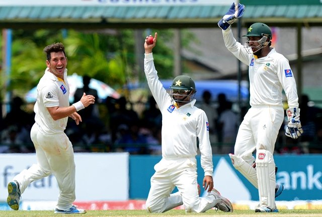 pakistan cricketer yasir shah l celebrates with teammates azhar ali c and wicketkeeper sarfraz ahmed after dismissing sri lankan cricketer lahiru thirimanne during the second day of the second test cricket match between sri lanka and pakistan at the p sara oval cricket stadium in colombo on june 26 2015 photo afp