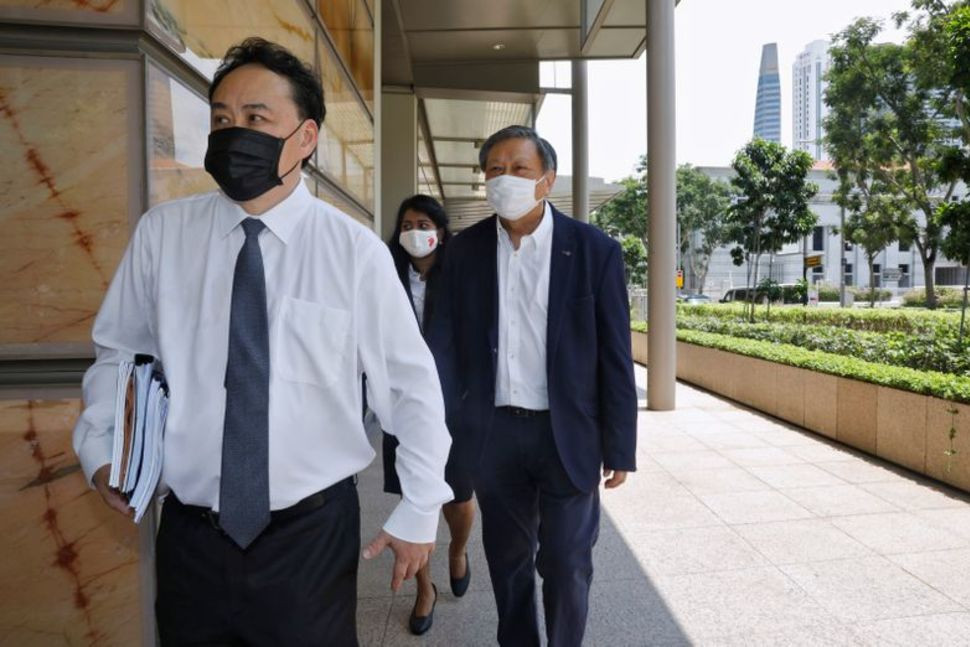 financial adviser and blogger leong sze hian r along with his lawyer lim tean leave the high court on the first day of their defamation hearing in singapore october 6 2020 photo reuters
