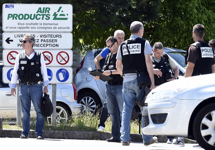 French police secure the entrance of the Air Products company in Saint-Quentin-Fallavier, near Lyon, central eastern France, on June 26, 2015. PHOTO: AFP