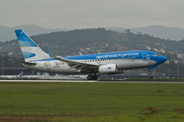 an aircraft of aerolineas argentinas the country 039 s largest airline takes off from runway photo afp