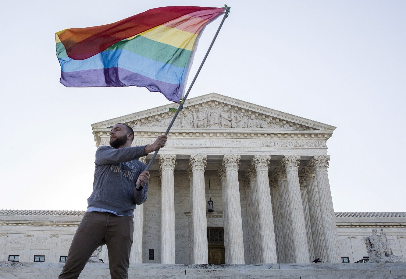 vin testa of washington dc waves a gay rights flag in front of the supreme court before a hearing about gay marriage in washington in an april 28 2015 file photo photo reuters
