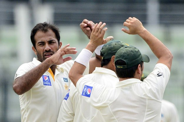 wahab riaz l celebrates with teammates after the dsimissal of unseen bangladesh batsman shuvagata hom during the third day of the second cricket test match between bangladesh and pakistan at the sher e bangla national cricket stadium in dhaka on may 8 2015 photo afp