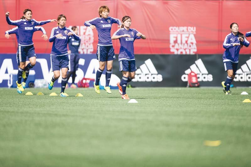 japanese players run through some drills during their training session in edmonton canada photo afp
