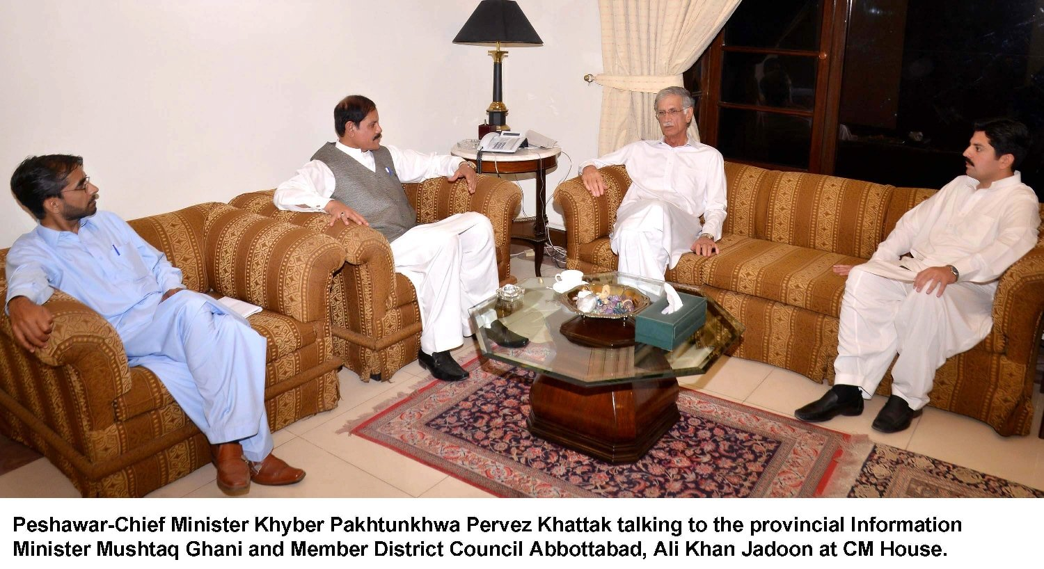 pervez khattak in a meeting with k p information minister mushtaq ghani among others at the cm house in peshawar on friday june 26 2015 photo express