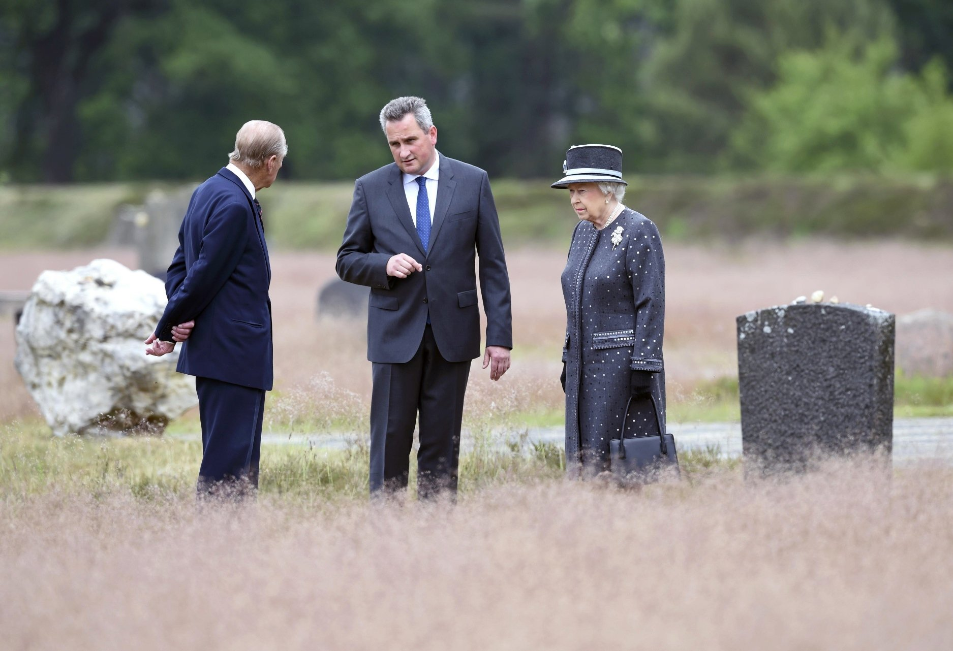 britain 039 s queen elizabeth ii and the duke of edinburg prince philip l are show the memorial site of former nazi concentration camp bergen belsen by memorial site director jens christian wagner c on june 26 2015 photo afp