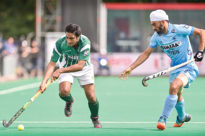 pakistan s rasool shafqat vies with india s gurmail singh during the group a field hockey match between pakistan and india photo afp