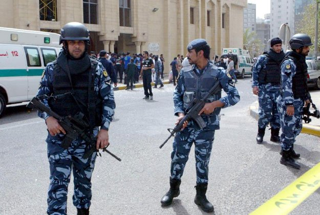 security forces gather outside the shia al imam al sadeq mosque after it was targeted by a suicide bombing during friday prayers in kuwait city on june 26 2015 photo afp