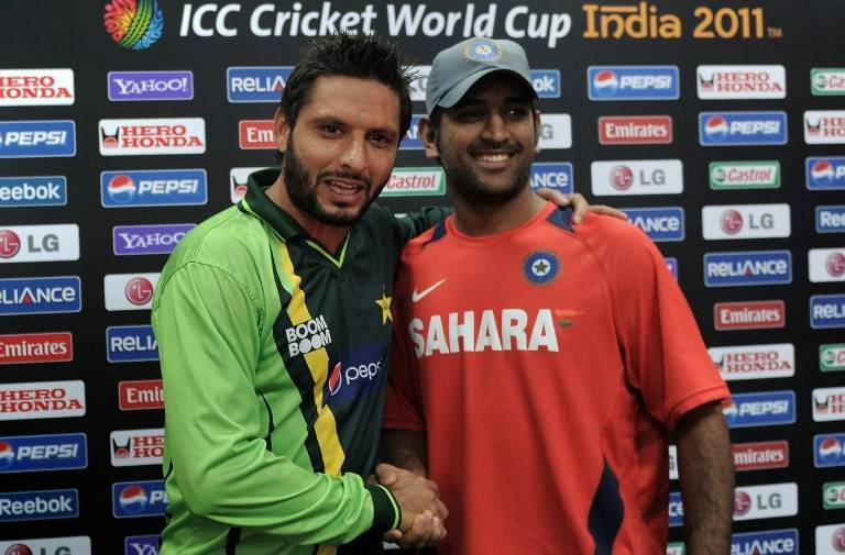 a file photo of shahid afridi and ms dhoni shaking hands at the icc cricket world cup 2011 photo file afp