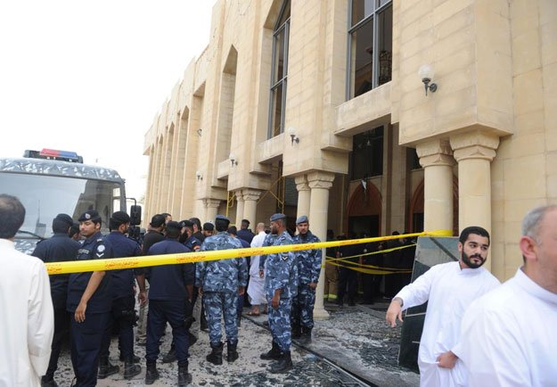 security forces and officials gather at a shia mosque after a deadly blast claimed by the islamic state group that struck worshippers attending friday prayers in kuwait city friday june 26 2015 photo afp