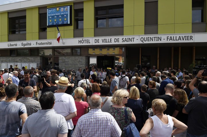 People assemble ahead of a minute of silence outside the city hall of Saint-Quentin-Fallavier on June 27, 2015, in memory to the victims of the attack on US-owned Air Products factory in the town. PHOTO: AFP