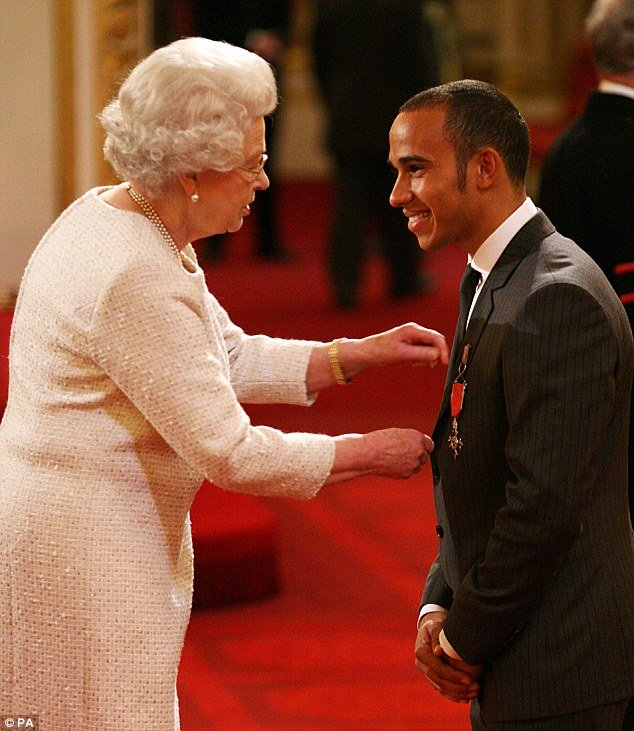 hamilton receiving the mbe from the queen photo courtesy daily mail