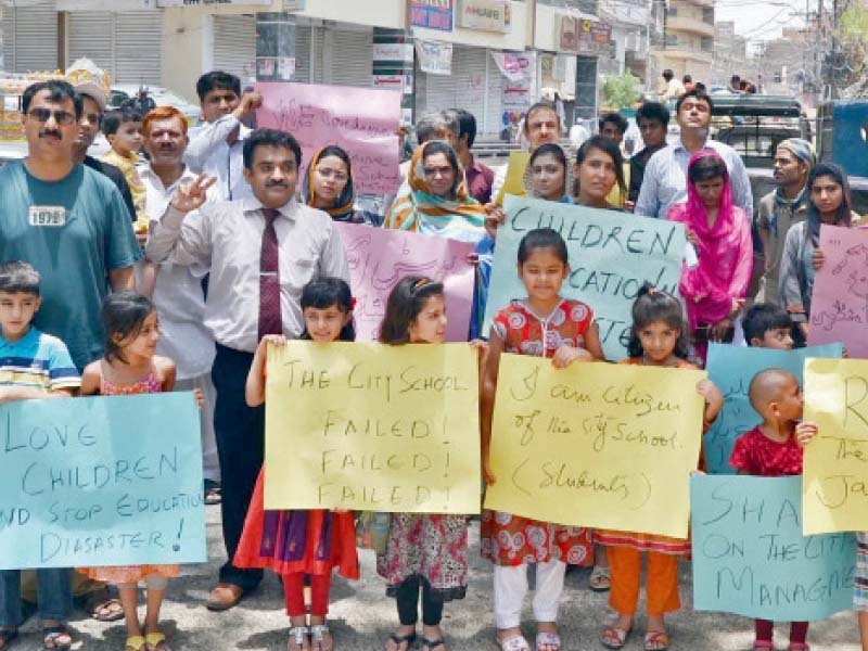 parents children and teachers stage a protest against the closure of the city school branch in jamshoro photo online