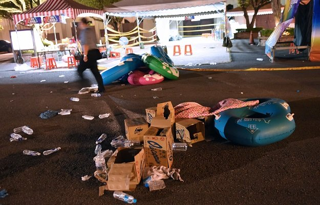 a police officer walks past debris at the formosa fun coast amusement park after an explosion in the pali district of new taipei city early june 28 2015 photo afp