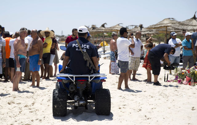 tunisian policemen patrol the beach in front of the riu imperial marhaba hotel in port el kantaoui on the outskirts of sousse south of the capital tunis on june 28 2015 following a shooting attack two days earlier photo afp