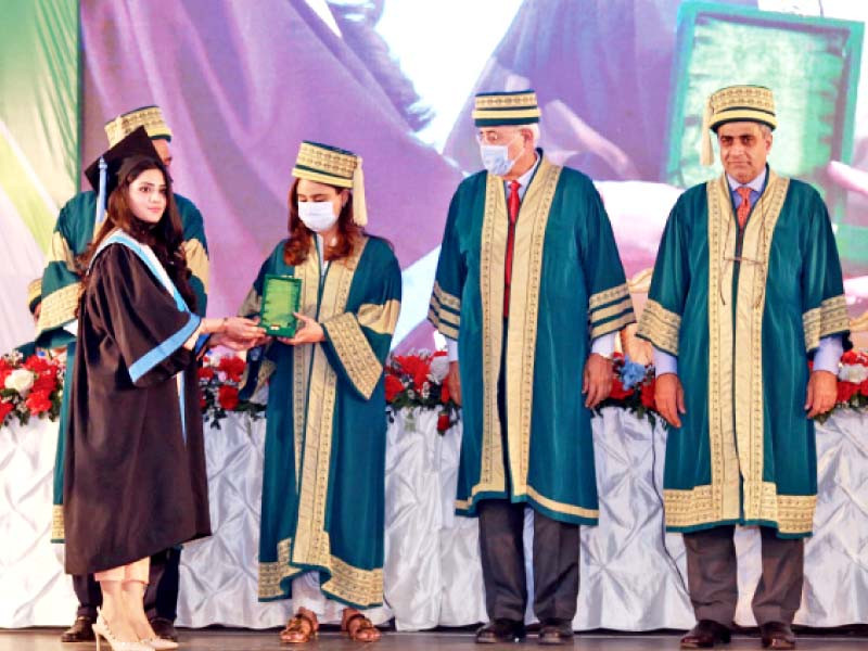 a student receives her degree at the 18th convocation of ziauddin university the university conferred degrees upon over 500 graduates on the occasion photo