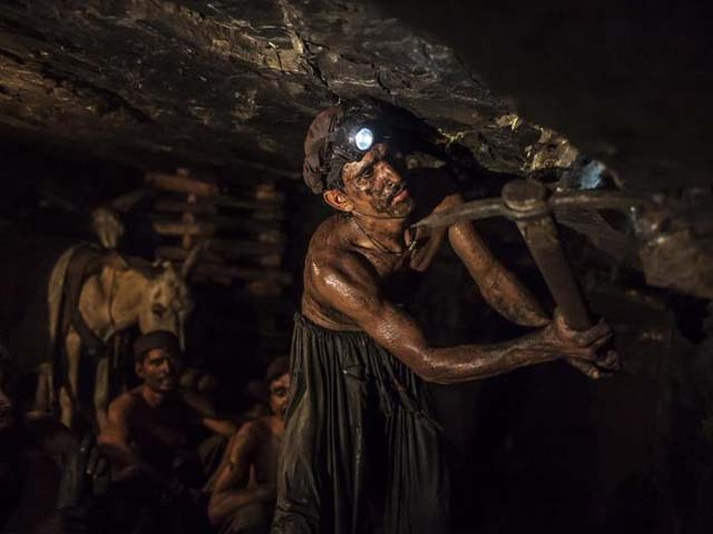 miner mohammad ismail 25 digs in a coal mine in choa saidan shah photo reuters