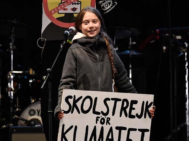 Swedish climate activist Greta Thunberg delivers a speech after a massive climate march in Madrid on Friday. PHOTO: AFP