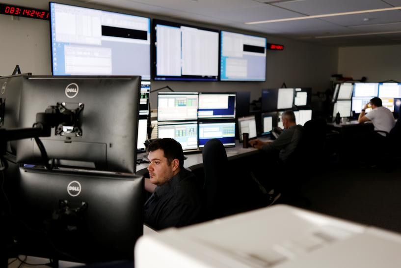 satellite controller sean sauve works at the offices of telesat a canadian satellite communications company in ottawa ontario canada march 24 2021 photo reuters