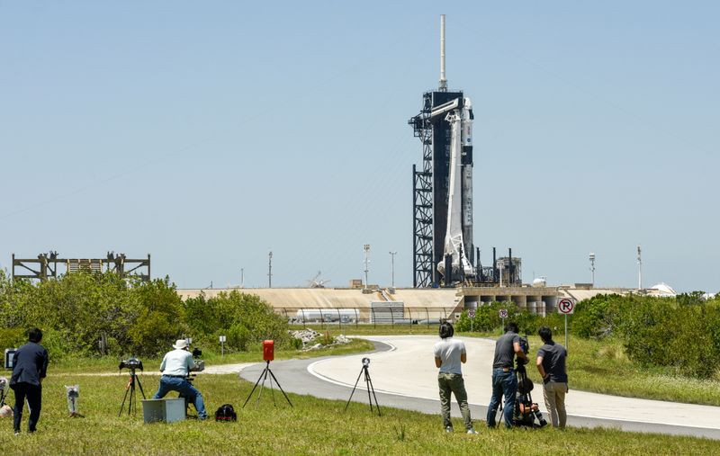 photographers set up remote cameras for the launch of a spacex falcon 9 rocket with the crew dragon capsule outside pad 39a for a mission to the international space station at kennedy space center in cape canaveral florida us april 22 2021 photo reuters