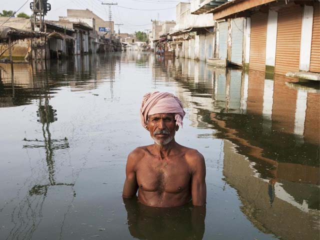 ahmed stands in the centre of the town of khairpur nathan shah which had been totally submerged by floodwaters photo getty