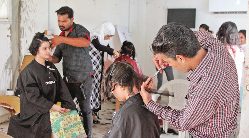volunteers donate hair for patients of cancer and other illnesses who lose hair during treatment the pakistan youth forum has undertaken the task of collecting donated hair to make wigs for such patients photo aysha saleem express