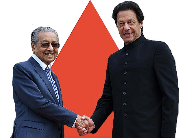 Malaysia's Prime Minister Mahathir Mohamad shakes hands with his Pakistani counterpart Imran Khan. PHOTO: GETTY