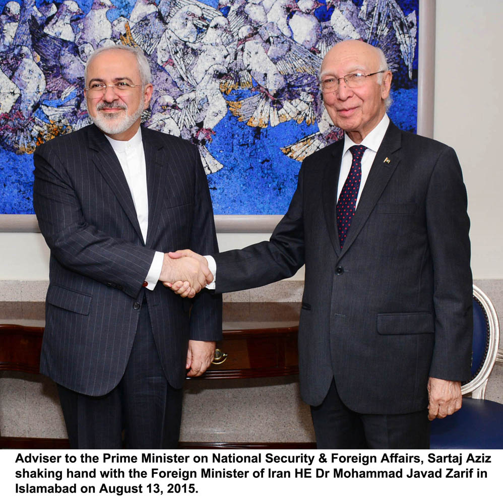 adviser to prime minister on national security and foreign affairs shakes hands with iranian foreign minister javad zarif in islamabad on august 13 2015 photo pid