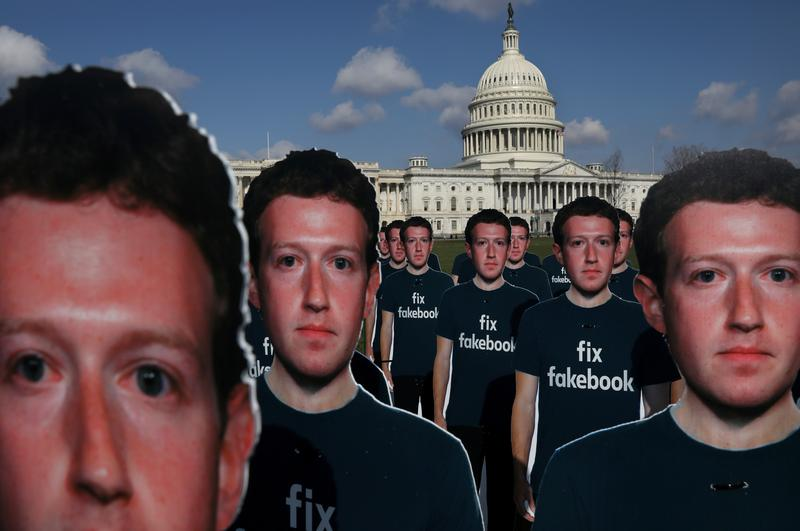 dozens of cardboard cut outs of facebook ceo mark zuckerberg sit outside of the us capitol building as part of an avaaz org protest in washington us april 10 2018 photo reuters