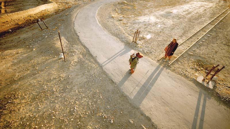 wahidullah and bagoo standing beside a broken railway track near khost photo syntax communications