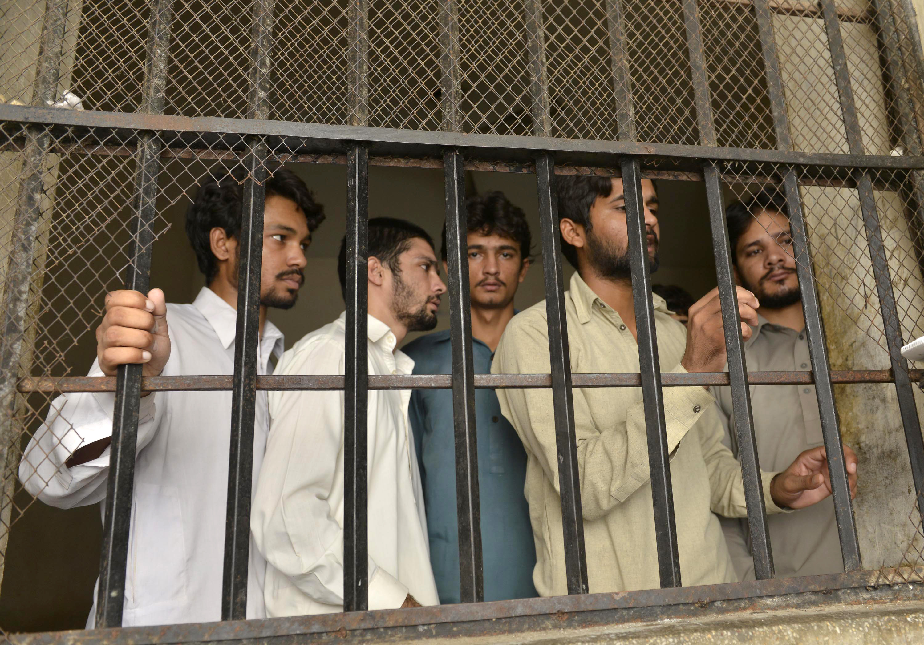 arrested gang members of a sexual abuse scandal stand in the police lockup in hussain khanwala village some 55 kms southwest of lahore on august 9 2015 photo afp