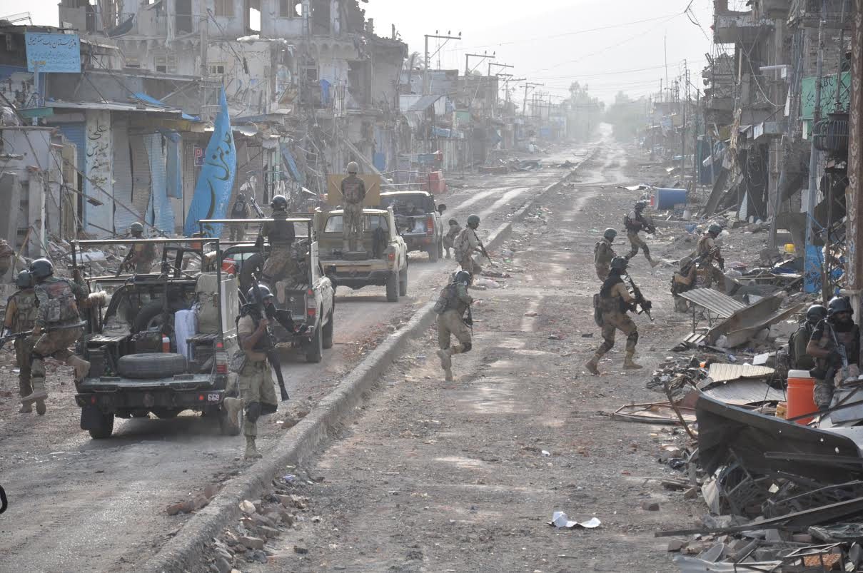 security forces troops can be seen busy in a operation photo file